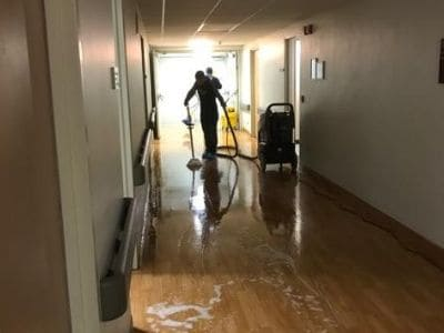 servicemaster team cleaning clinic floor