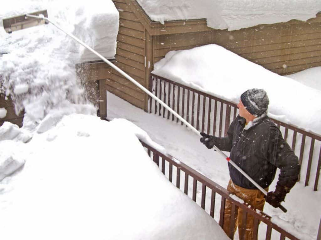 raking snow from roof in chicago home ice dam
